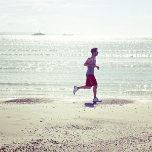 man jogging on the beach - Image Credit: Kate hiscock (Flickr)