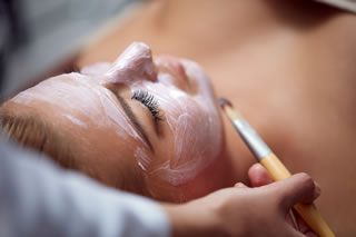 A woman having a facial in a spa