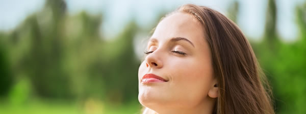 Healthy woman breathing