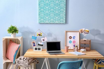 Wooden desk with photos and laptop