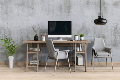 Wooden desk in a grey room