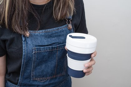 Woman carrying a reusable mug
